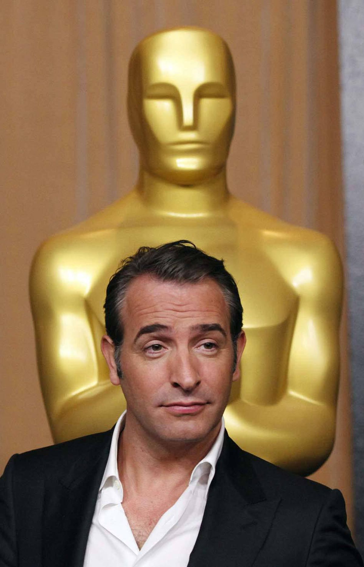 A Gallicly confident Jean Dujardin arrives at the 84th Academy Awards nominees luncheon in Beverly Hills on Monday.