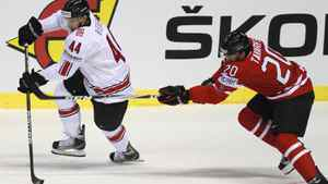 John Tavares of Canada (R) challenges Switzerland's Matthias Bieber during their preliminary round group B game at the Ice Hockey World Championships in Kosice May 3, 2011.
