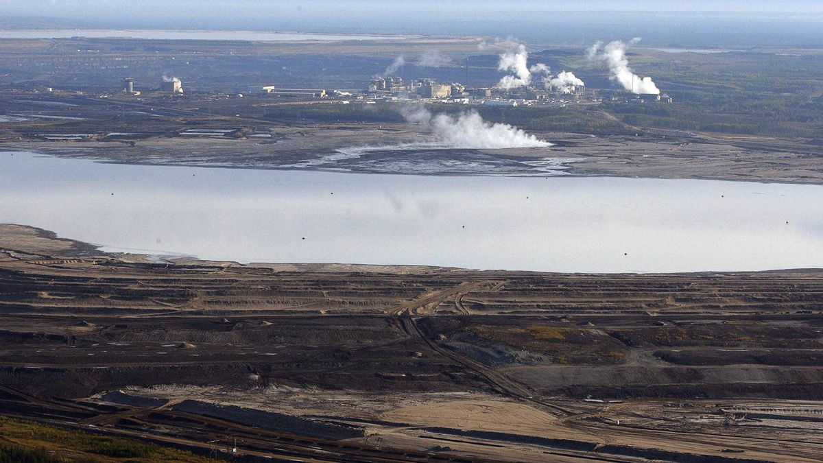 This Sept. 19, 2011 aerial photo shows an oil sands tailings pond at a mine facility near Fort McMurray, Alta.