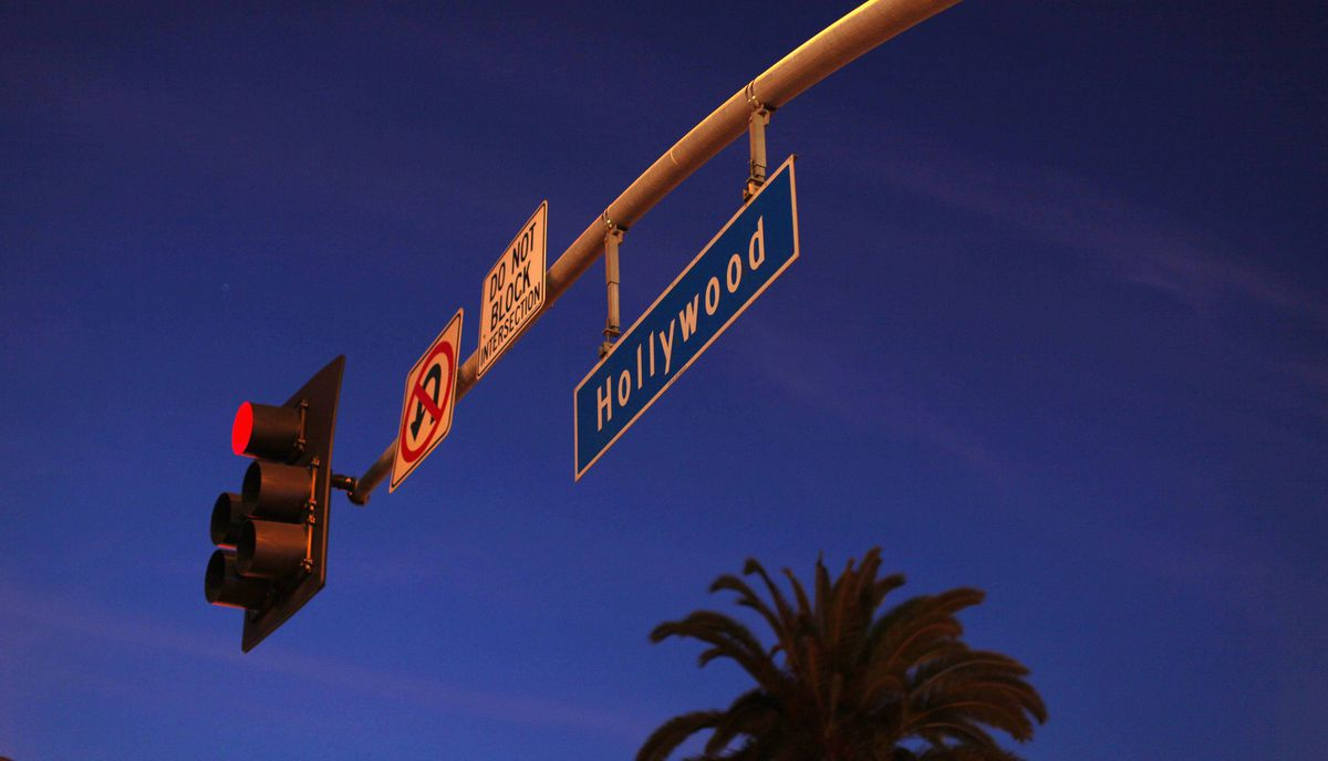 A Hollywood street sign hangs from an intersection lights along Hollywood Boulevard in Hollywood, California February 22, 2012.