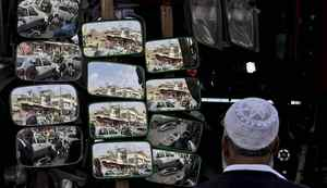 A Pakistani man looks at mirrors displayed for sale outside an accessory shop for cars, in Rawalpindi, Pakistan, Wednesday, Feb. 22, 2012. (AP Photo/Muhammed Muheisen)