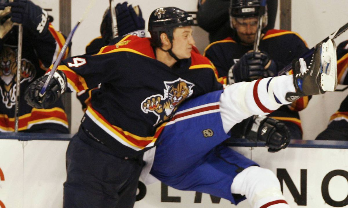 Florida Panthers' Jay Bouwmeester, left, slams Montreal Canadiens' Michael Ryder into the boards during a game in Sunrise, Fla., on Nov. 16, 2006.