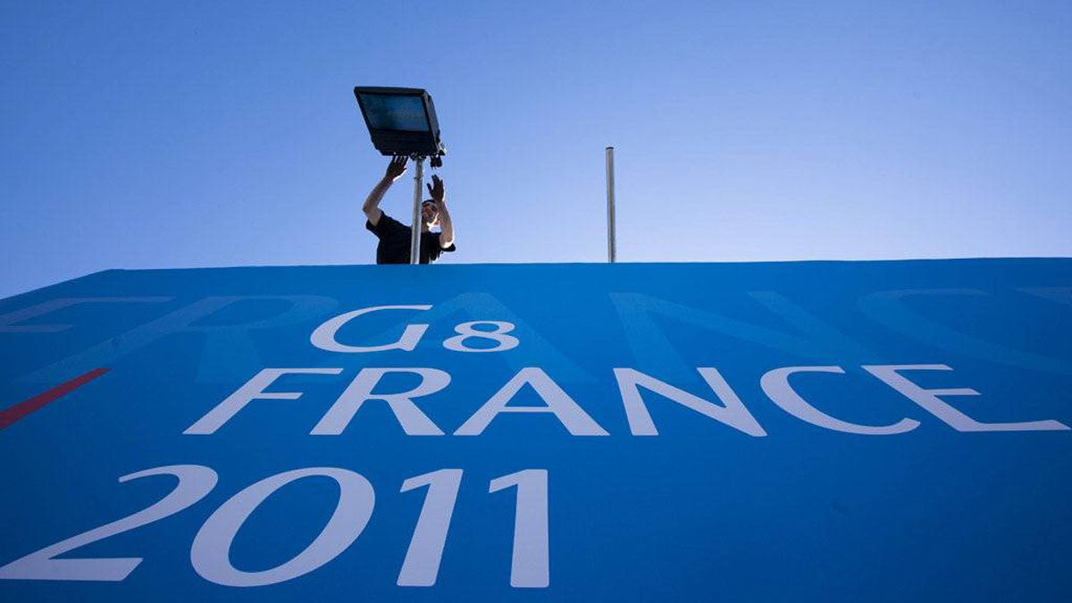 A man installs floodlights outside of the Deauville Congress Center, in Deauville western France, Monday, May 23, 2011, where world leaders of the G8 will meet for a summit May 26 and May 27.