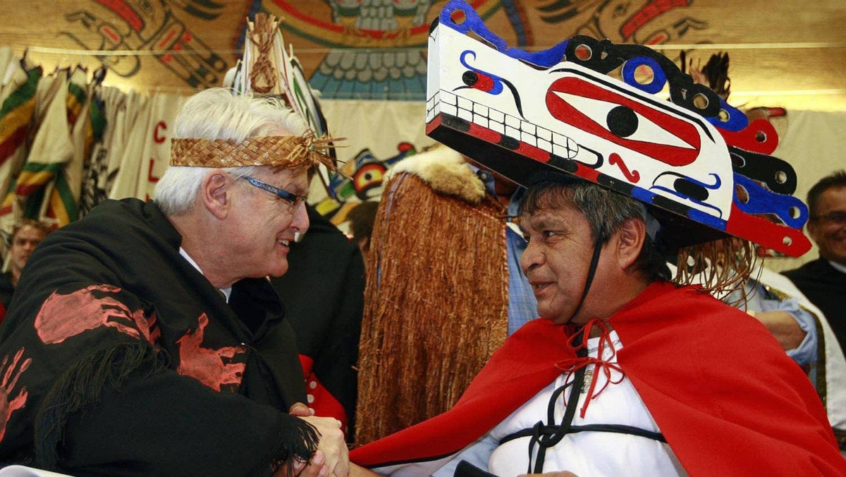 Former B.C. Premier Gordon Campbell shakes hands with Chief Alex Frank during a treaty signing ceremony in Tofino, B.C. November 13.