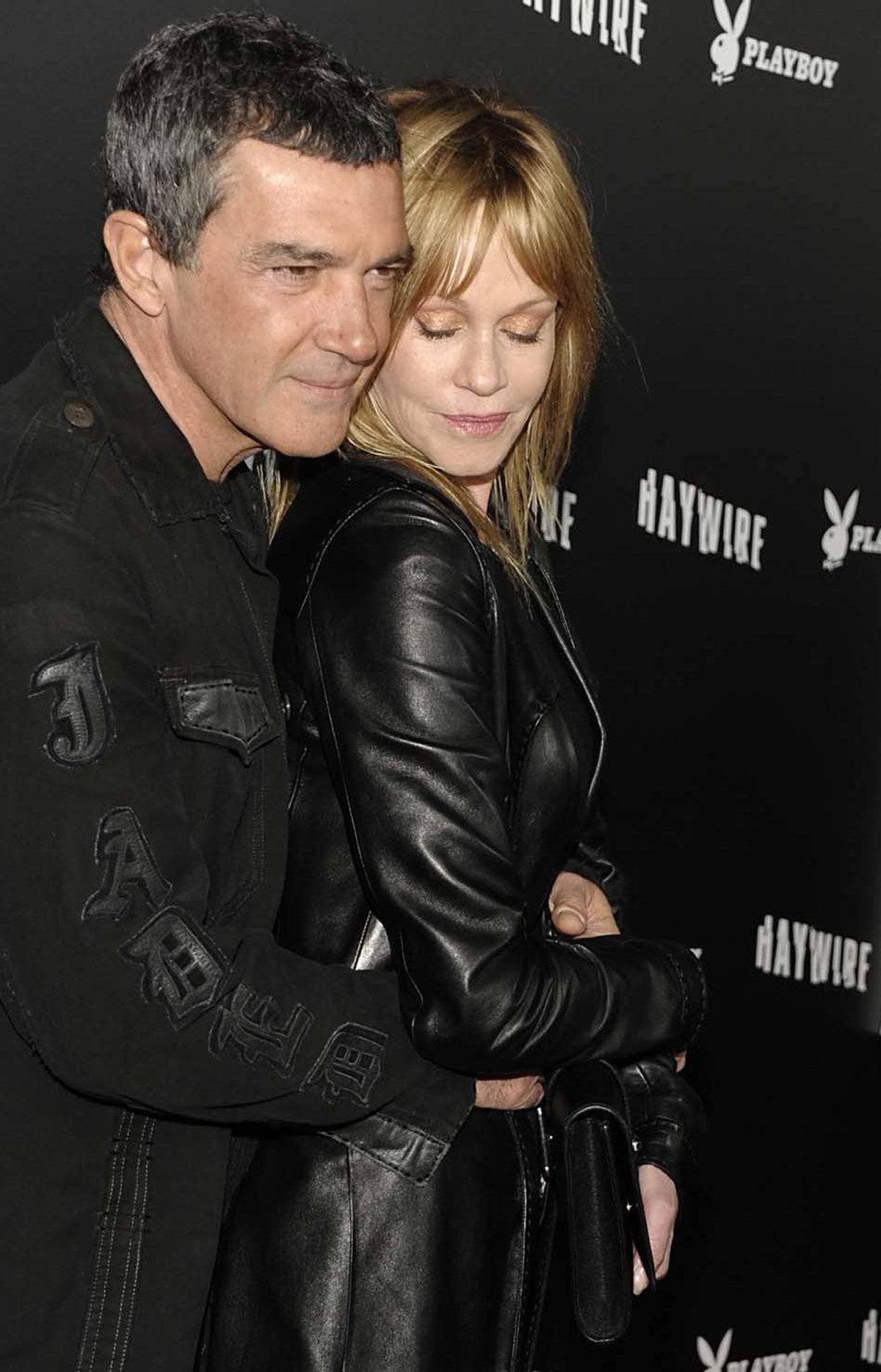 """Antonio Banderas poses for photos on the red carpet for the film """"Haywire"""" in Los Angeles last week while his wife Melanie Griffith takes one of her """"naps."""""""