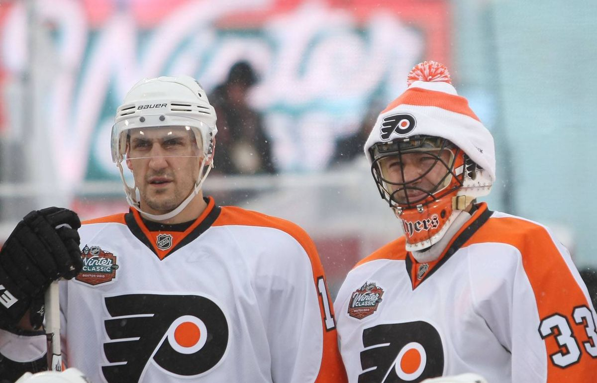 Blair Betts #11 and Brian Boucher #33 of the Philadelphia Flyers pose for a team picture before practice for the Bridgestone NHL Winter Classic on December 31, 2009 at Fenway Park in Boston, Massachusetts. (Photo by Elsa/Getty Images)