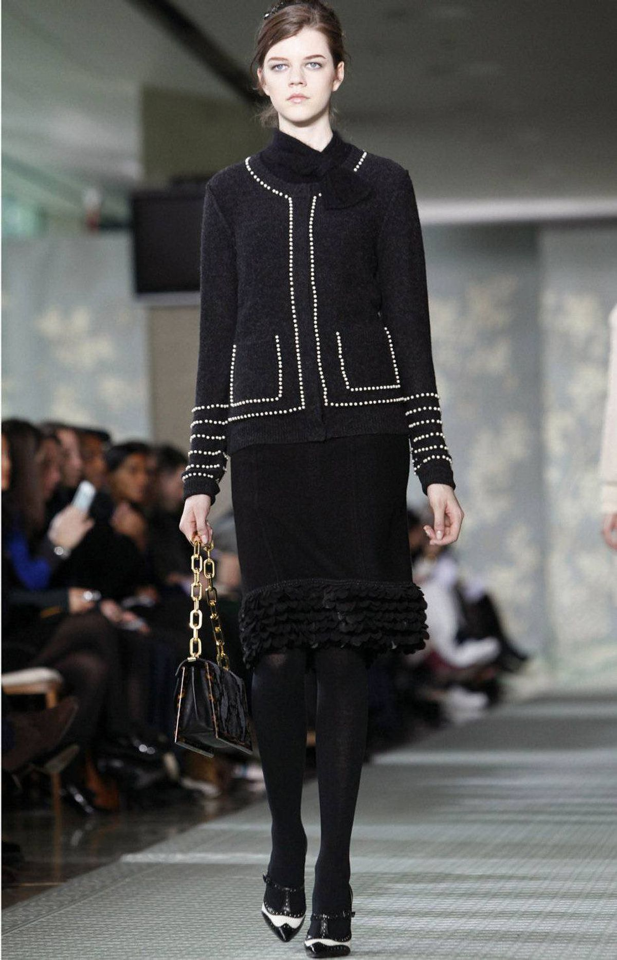 """On Tuesday morning, Tory Burch showed a collection inspired by a """"prim girl who's under the spell of the wrong kind of guy,"""" according to the program notes. """"She's an innocent, unaware of her own sex appeal."""""""
