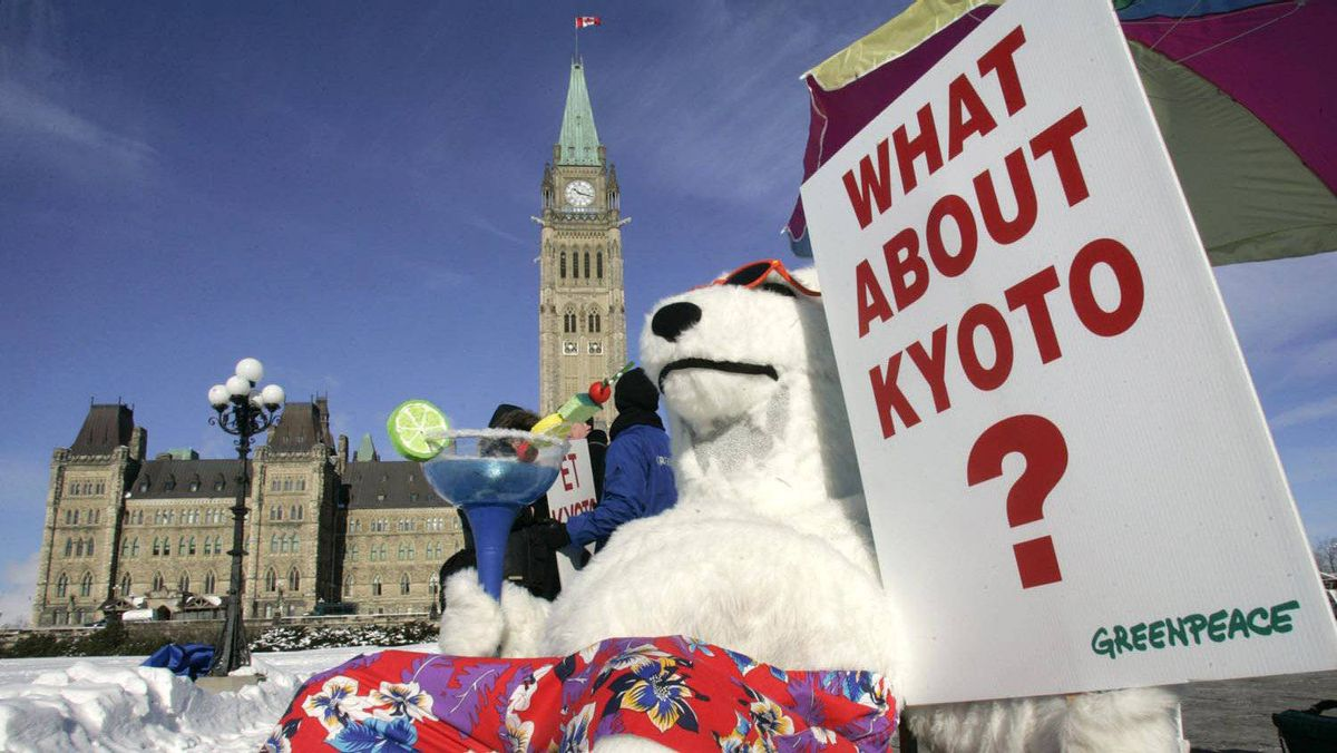 A Greenpeace activist dressed in a polar bear costume demonstrates in front of Parliament Hill to call on Canada's Conservative government to meet its commitments under the Kyoto Protocol, in Ottawa in January 2007.