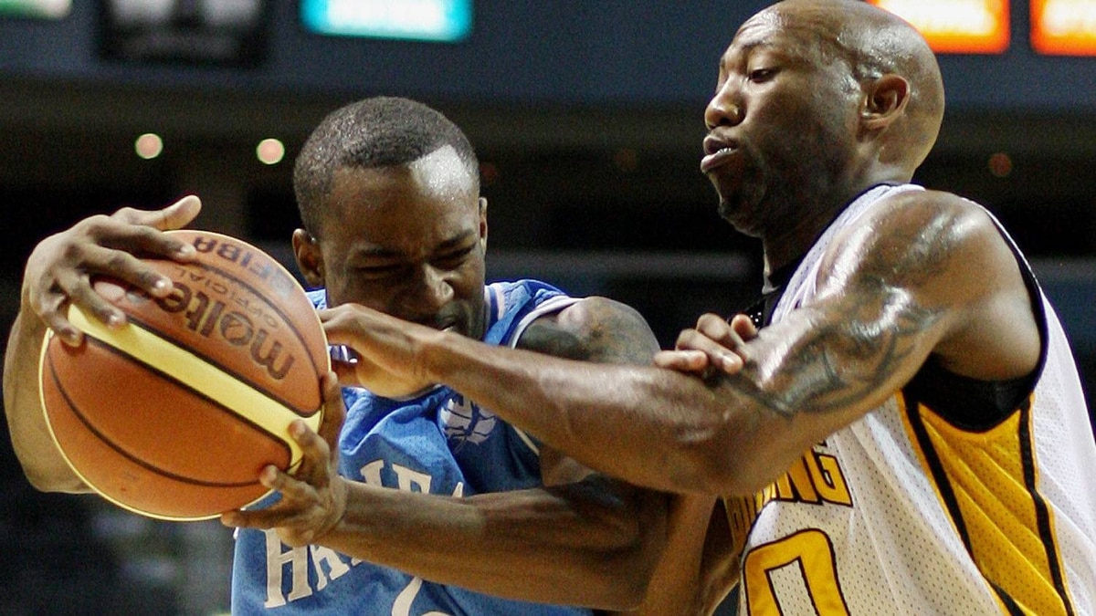Halifax Rainmen's Chris Hagan drives to the basket as London Lightning's Eddie Smith tries to get a hand on the ball in National Basketball League (NBL) championships series game one, second half action in London, Ontario, Sunday, March 18, 2012. THE CANADIAN PRESS/Dave Chidley