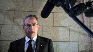Natural Resources Joe Oliver speaks to reporters in the foyer of the House of Commons on Feb. 27, 2012.