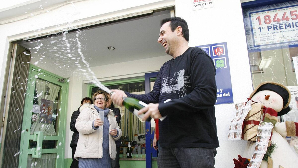 People celebrate winning a portion of Spain's Christmas lottery 'El Gordo' Thursday in Granen, northern Spain, December 22, 2011. The lottery has provided a rare bright spot for a nation hammered by unemployment and the global financial crisis.