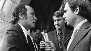 Reporters Tim Ralfe, right, and Peter Reilly, centre, question Prime Minister Pierre Trudeau on the steps of Parliament Hill about the FLQ crisis and the invocation of the War Measures Act. Peter Bregg/CP