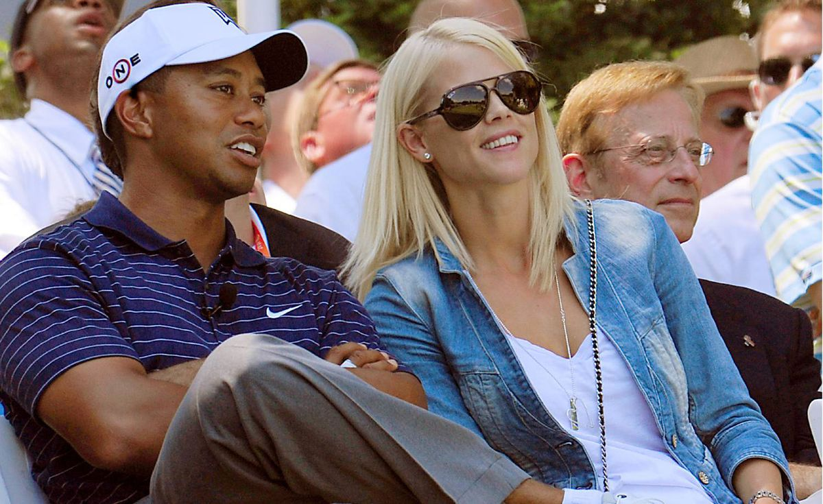 Tiger Woods speaks with his wife Elin Nordegren during ceremonies on July 1, 2009 at the AT&T National golf tournament hosted by Woods at the Congressional Country Club in Bethesda, Maryland.