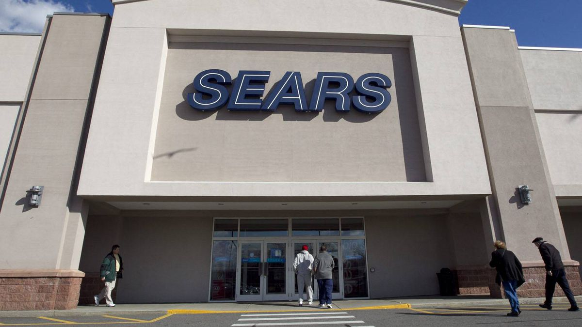 In this Feb. 22, 2012 photo, shoppers enter a Sears department store location in Dedham, Mass.