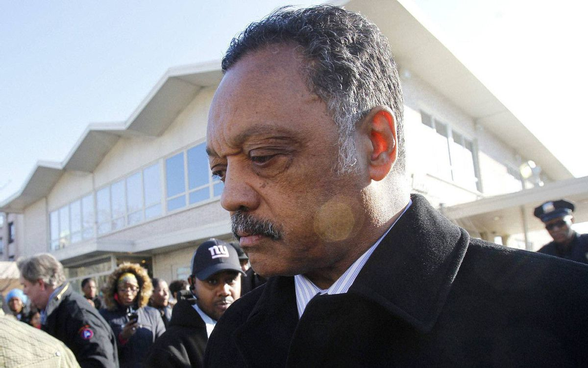 The Rev. Jesse Jackson leaves Whigham Funeral Home after visiting with the family of Whitney Houston before going to the New Hope Baptist Church for her funeral in Newark, N.J. on Saturday, Feb. 18, 2012.
