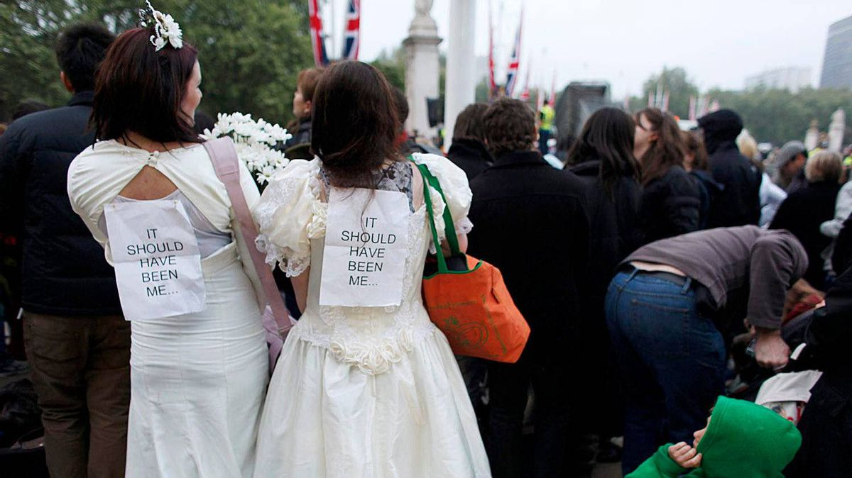 Royal fans dressed as brides wait with many others for the beginning of the Royal Wedding near Buckingham Palace in London April 29, 2011.