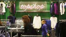 People look at clothes in a TopShop store in London.