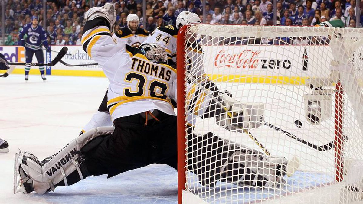 Tim Thomas of the Boston Bruins gives up a goal to Maxim Lapierre of the Vancouver Canucks in the third period.