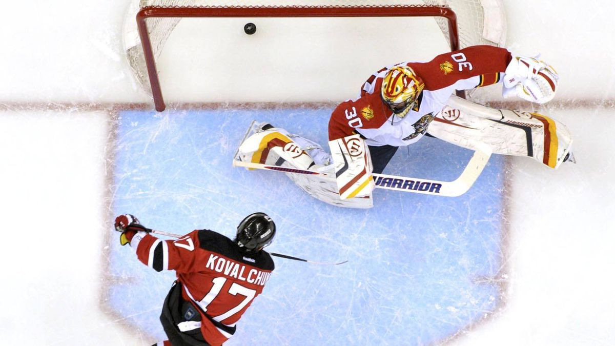 New Jersey Devils' Ilya Kovalchuk (L) scores on Florida Panthers goalie Scott Clemmensen during the second period of Game 6 of their NHL Eastern Conference quarter final playoff hockey game in Newark, April 24, 2012. REUTERS/Ray Stubblebine