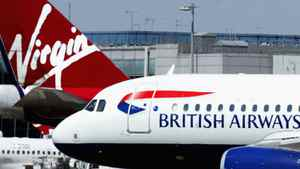 A British Airways aircraft taxis past it's rival carrier Virgin at Heathrow airport