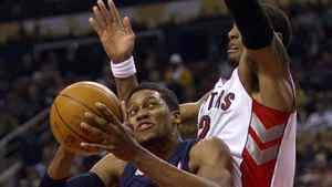 Memphis Grizzlies' Rudy Gay jumps to the net as Toronto Raptors' James Johnson defends during first half NBA play in Toronto on Friday, March 2, 2012. THE CANADIAN PRESS/Pawel Dwulit