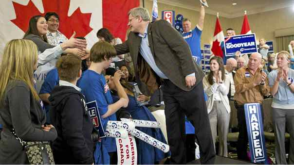 Prime Minister Stephen Harper shakes hands with supporters during a campaign event in Guelph Ont., on Monday, April 4, 2011.