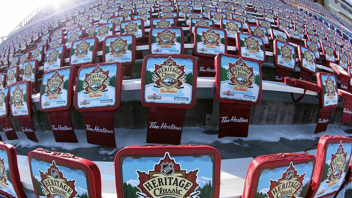 Snow covered seat cushions await the arrival of fans prior to the 2011 NHL Heritage Classic Game at McMahon Stadium on February 20, 2011 in Calgary, Alberta, Canada. (Photo by Andre Ringuette/Getty Images)