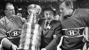 Montreal Canadiens coach Toe Blake, centre, re-enact in 1983 the team's fifth Stanley Cup title with Maurice (The Rocket) Richard and Jacques Plante, right.