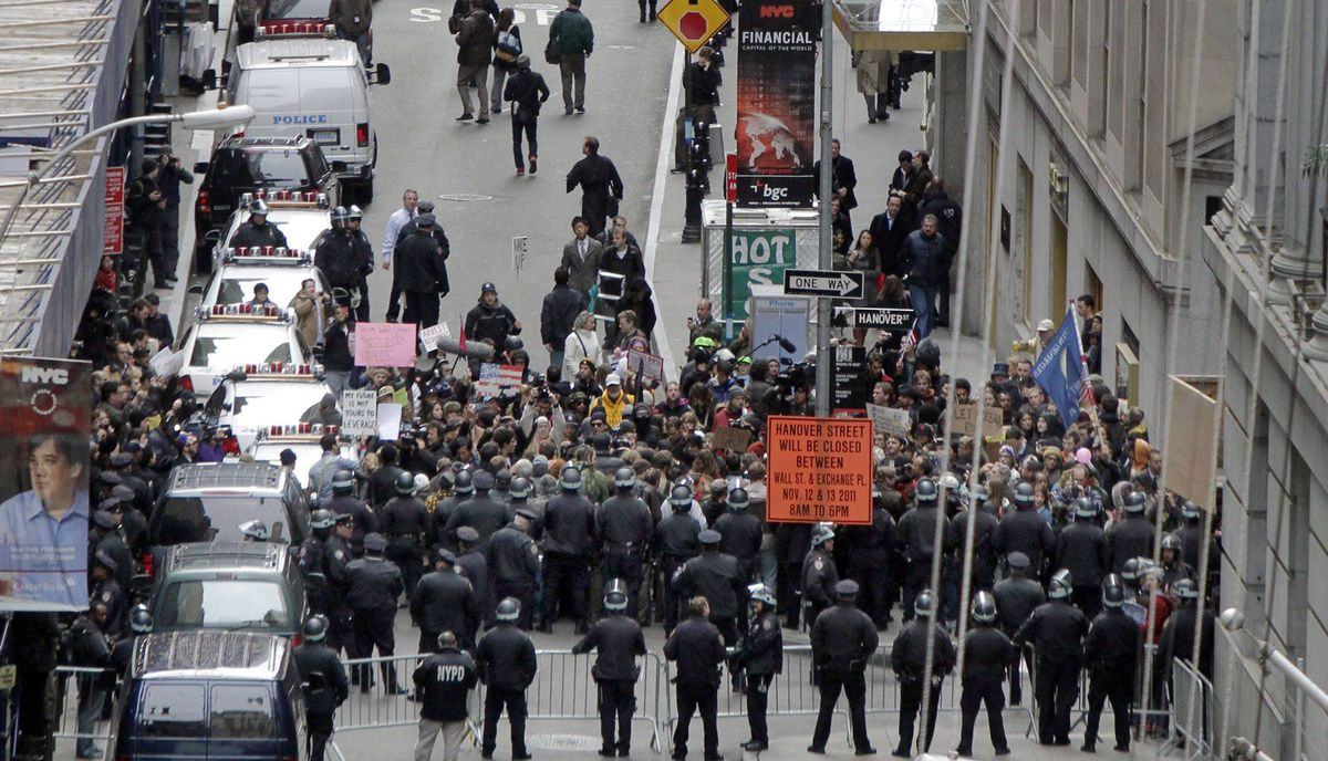 New York City Police officers prevent protestors from entering Wall Street from the east, Thursday, Nov. 17, 2011.