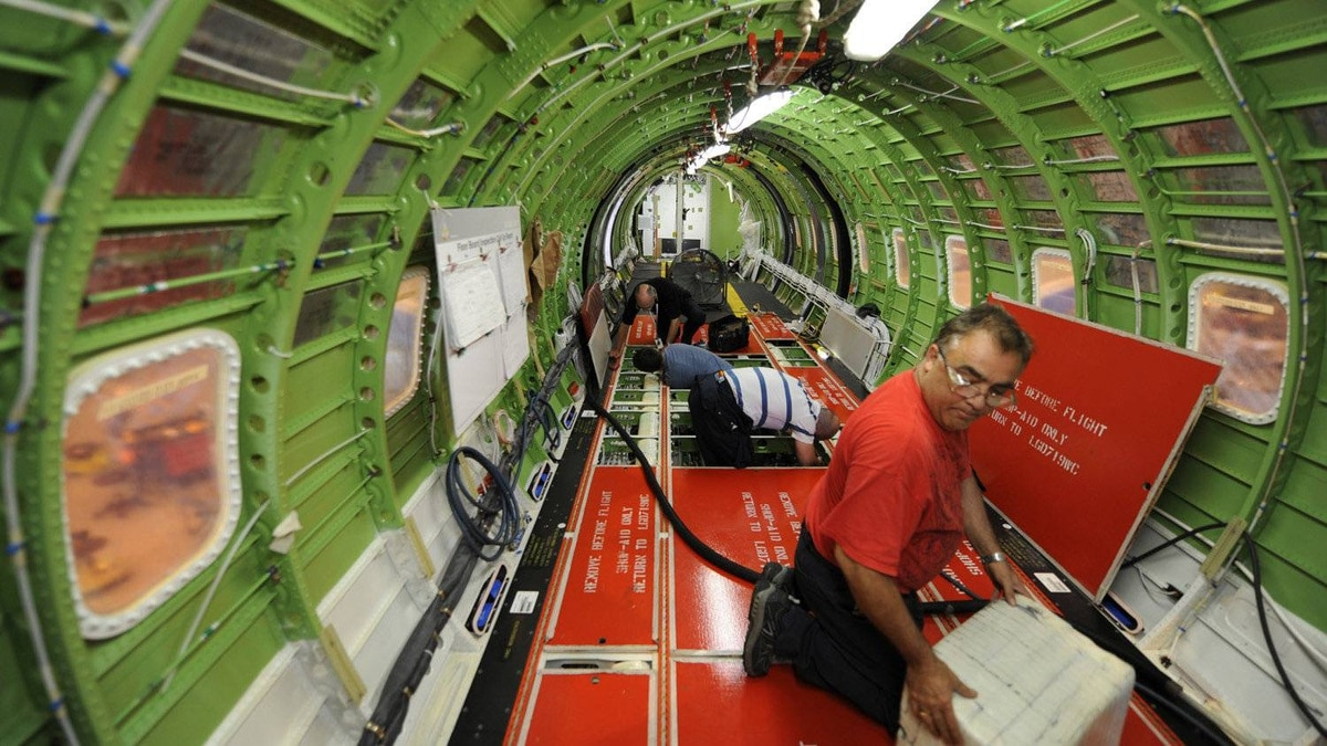 Workers lay cables and wiring in a Global Express jet being manufactured at Bombardier Inc.'s Toronto assembly plant on Tuesday.