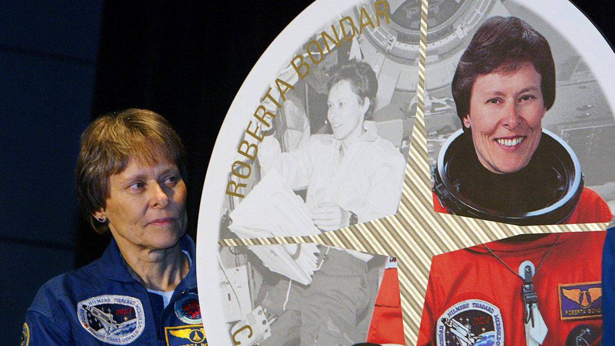 Astronaut Roberta Bondar stands beside a stamp featuring her likeness at the John H. Chapman Space Centre in St-Hubert, Que., on Friday, Sept. 26, 2003. The stamp was one of eight unveiled by Canada Post to honor Canadian astronauts.