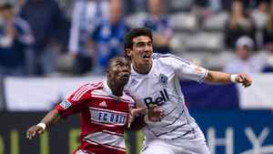 FC Dallas' Fabian Castillo, left, of Colombia, left, and Vancouver Whitecaps' Omar Salgado battle for control of the ball during the first half of an MLS soccer game in Vancouver, B.C., on Saturday April 21, 2012.