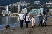 Andrew Loo along with his wife, Jobina, and their kids Sienna, 11, Anderson, 9, and Rachel, 7, and dog Sesame are pictured at Ambleside beach in West Vancouver, on Jan. 12, 2019.