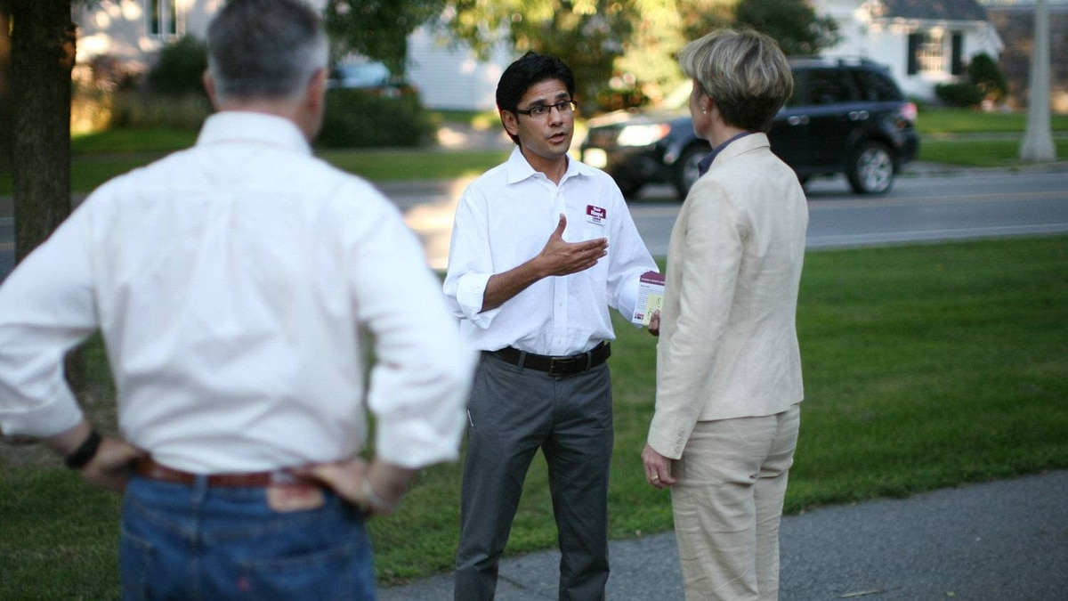Liberal candidate Yasir Naqvi, the incumbent, speaks with constituents while canvassing in his Ottawa Centre riding on August 26, 2011.
