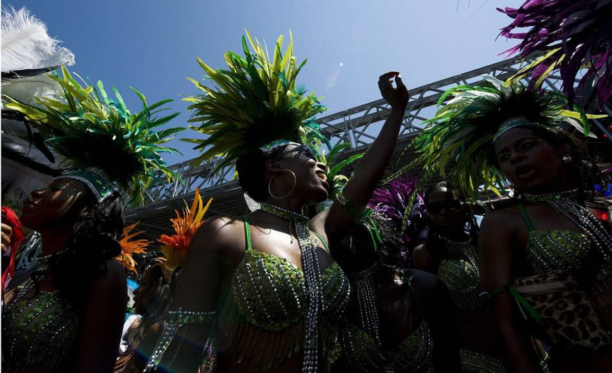 Revelers take part in the 2010 Caribana Parade in Toronto on Saturday, July 31, 2010.