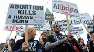Anti-abortion activists take part in the annual March For Life rally on Parliament Hill on May 10, 2012.