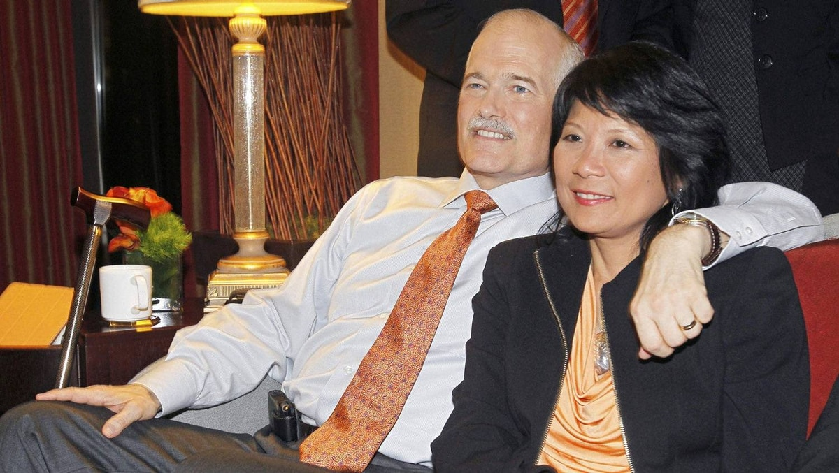 NDP Leader Jack Layton and his wife Olivia Chow watch federal election results at his headquarters in Toronto on May 2, 2011.