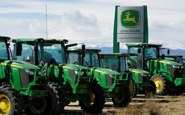Trade war, flooding hurt Deere