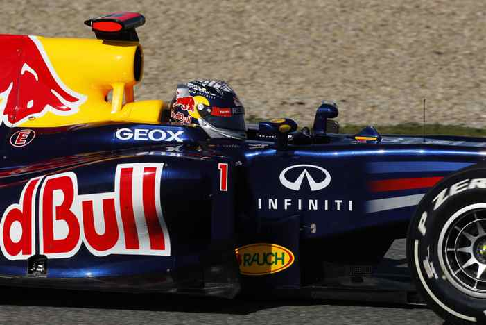 Red Bull Formula One driver Sebastian Vettel of Germany drives the RB8 during a training session at the Jerez racetrack in southern Spain February 9, 2012. REUTERS/Marcelo del Pozo (SPAIN - Tags: SPORT MOTORSPORT)