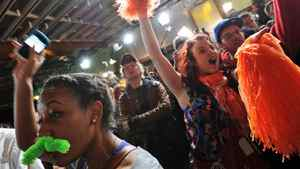 NDP supporters celebrate at Jack Layton's campaign headquarters in Toronto on May 2, 2011.