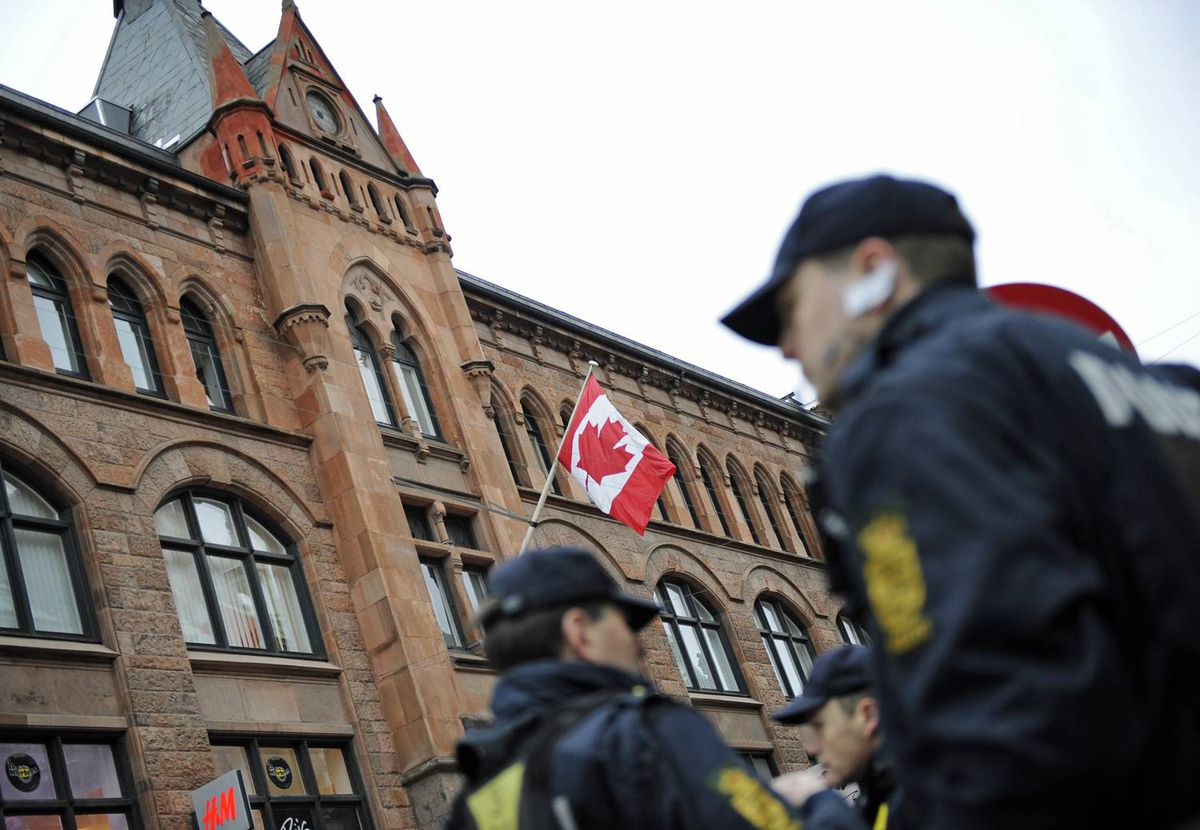 Danish police officers stand guard outside the Canadian embassy in Copenhagen on Monday, December 14, 2009.