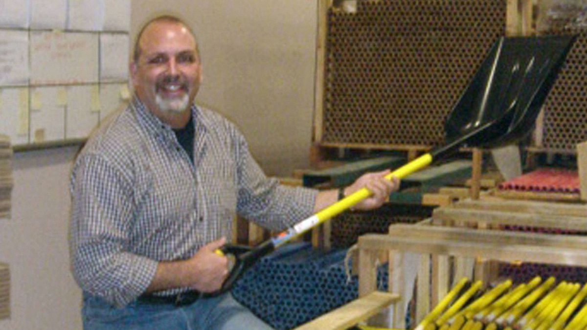 Trail Blazer Products Ltd. vice-president Shawn Levangie holds a Trail Blazer shovel manufactured at the company's Dartmouth, N.S. plant.