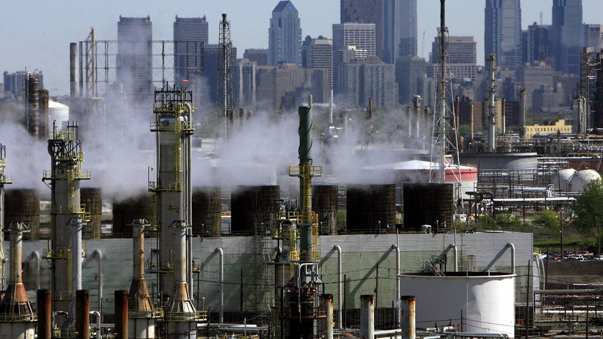 The Sunoco Philadelphia Refinery, a plant which is part of Sunoco's refining and supply business that manufactures gasoline, diesel, jet fuel and other petrochemicals, is backdropped by the Philadelphia skyline Friday April 28, 2006.