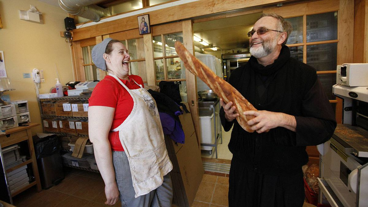 Pastry and sweets baker Stephanie Smith shares a laugh with Father Roberto Ubertino, executive director of St. John the Compassionate Mission and St. John's Bakery in the bakery on Broadview Avenue in Toronto.