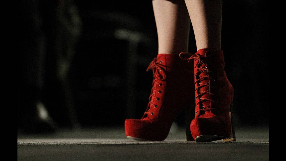A female delegate to the Liberal convention in Ottawa matches her red boots to the party colours.