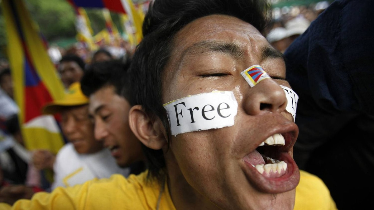 A Tibetan exile shouts slogans during a protest to mark the 52nd anniversary of the Tibetan uprising against China, in New Delhi March 10, 2011.