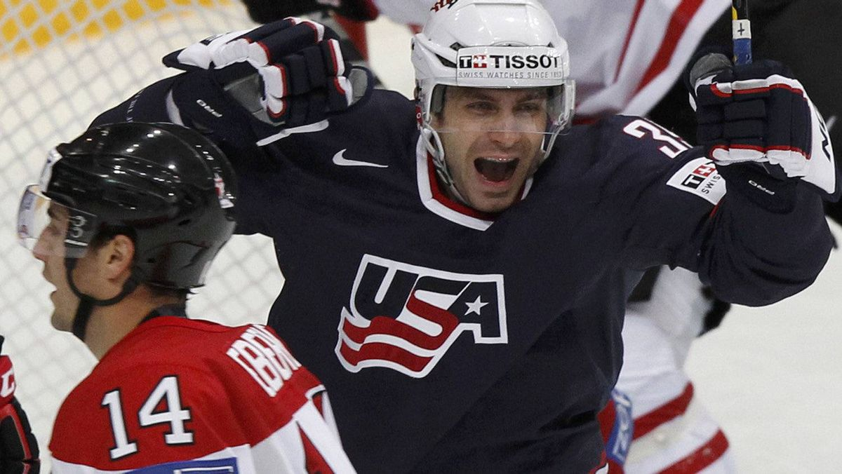 Patrick Dwyer (R) of the U.S. celebrates after scoring next to Canada's Jordan Eberle during their 2012 IIHF ice hockey World Championship game in Helsinki May 5, 2012. The U.S. won 5-4.REUTERS/Grigory Dukor