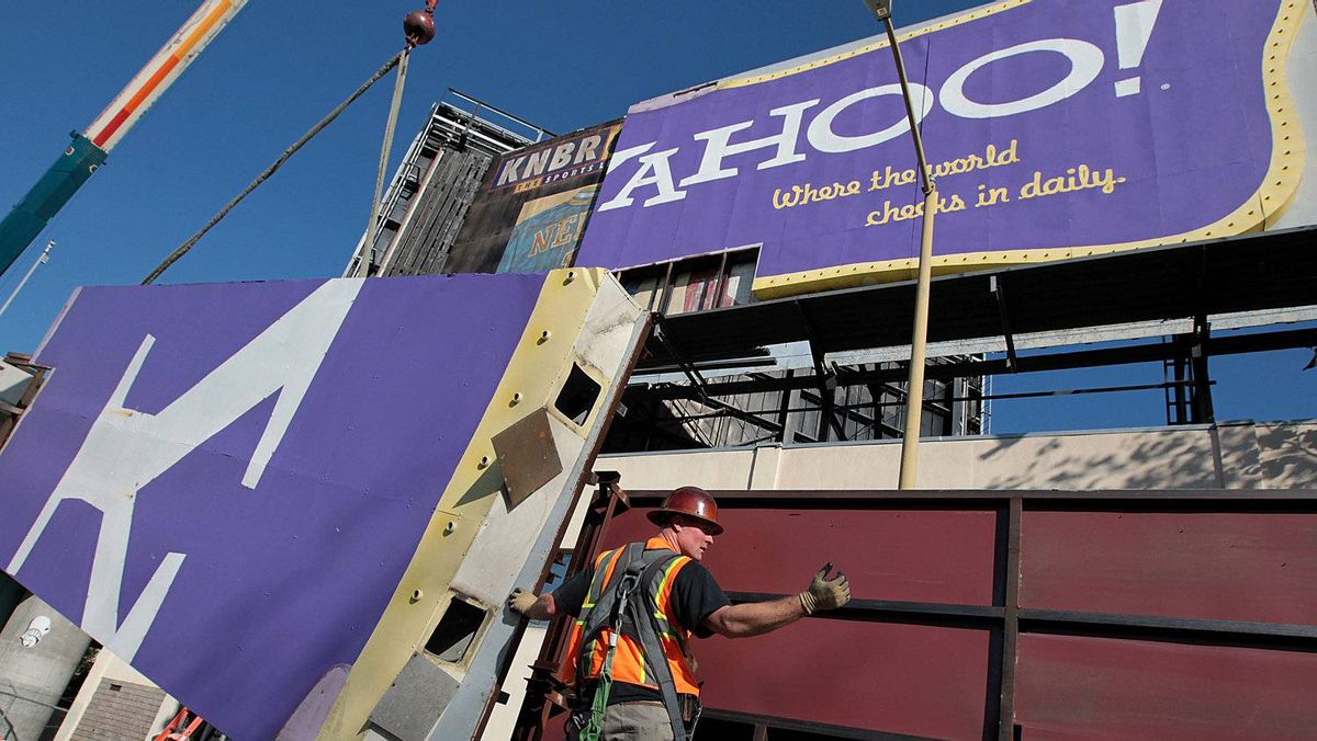 A worker moves a section of a Yahoo! billboard onto a truck on December 21, 2011 in San Francisco, California.