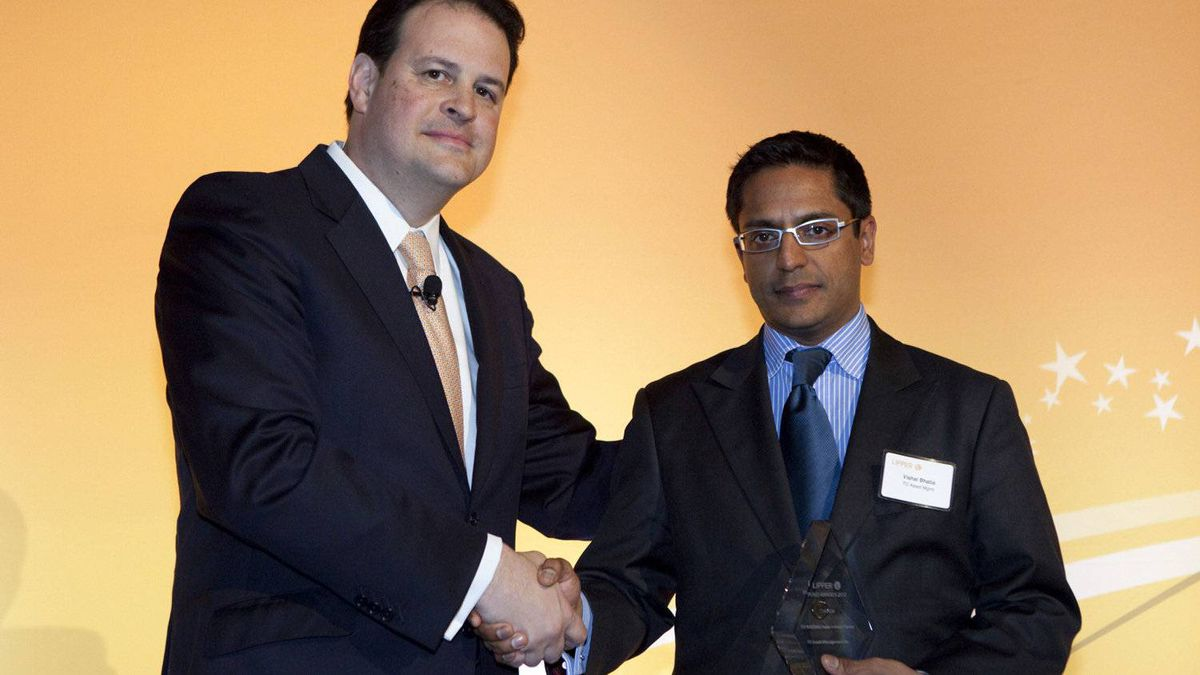 Jim Weber of Thomson Reuters, left, with Vishal Bhatia, who accepts an award for the TD Nasdaq Index Investor Series for three-year performance in the U.S. equity category.