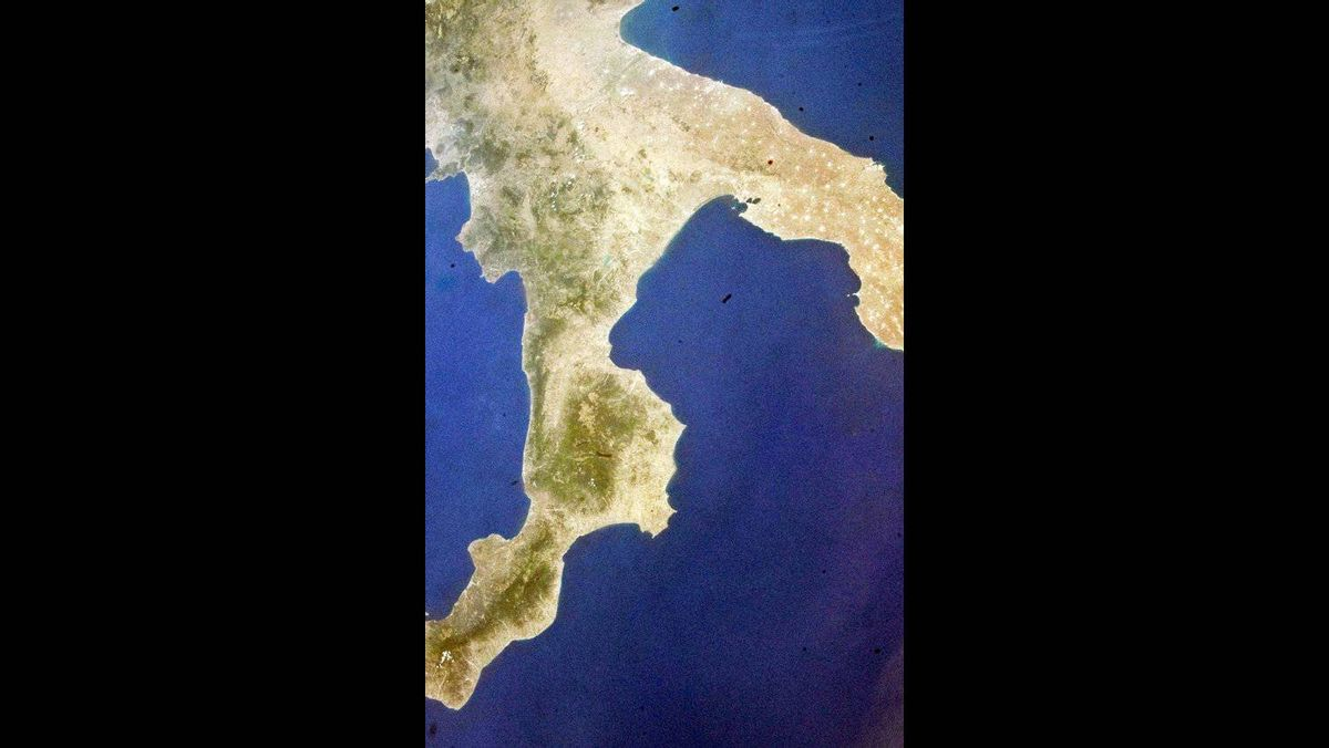 IN SPACE - JULY 9: the southernmost part of Italy is seen from the Earth-orbiting NASA space shuttle Atlantis on the second day of activity July 09, 2011 in space.